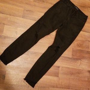 Lightly distressed black jeans
